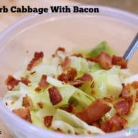 Keto Cabbage With Bacon in a clear plastic bowl with a fork