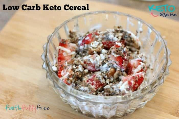 keto cereal with coconut milk and strawberries in a glass bowl