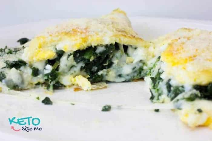 keto omelette with spinach and mozzarella cheese cut in half on plate