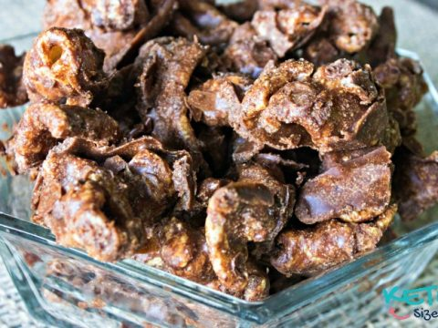 Keto Pork Rind Chocolate Puppy Chow in a glass bowl