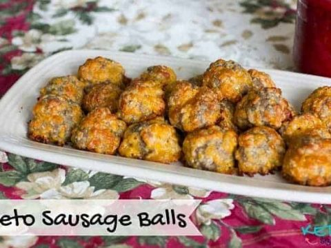 Keto sausage balls on a platter with holiday table cloth