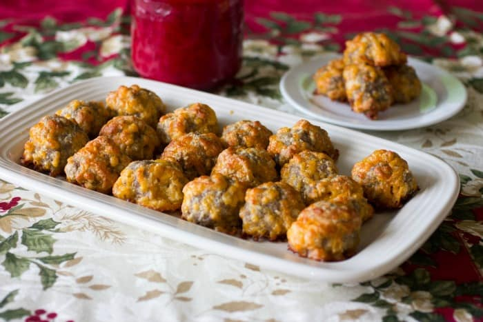 keto sausage balls on a holiday table with red candle