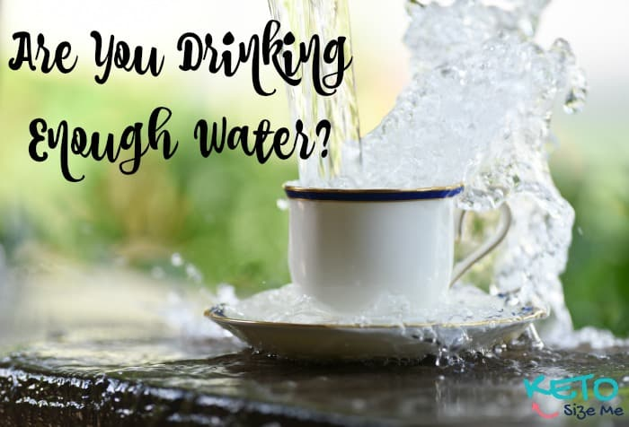 text says are you drinking enough water image is a mug with water splashing out of it