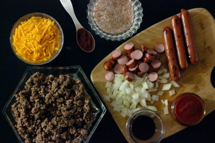 Low Carb High Fat Keto Chili Cheese Dog Casserole. Ground beef, hot dogs, homemade chili, and cheese baked to perfection.
