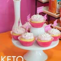 Keto Coconut Raspberry Cupcake on cake stand
