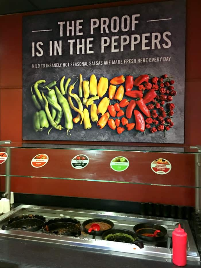 Sign inside Moe's Southwest Grill with peppers on it - Salsa bar