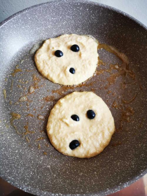keto pancakes cooking in skillet